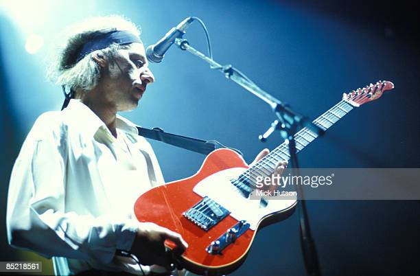 ARENA Photo of DIRE STRAITS and Mark KNOPFLER Mark Knopfler performing live onstage playing Schecter Telecaster guitar wearing headband