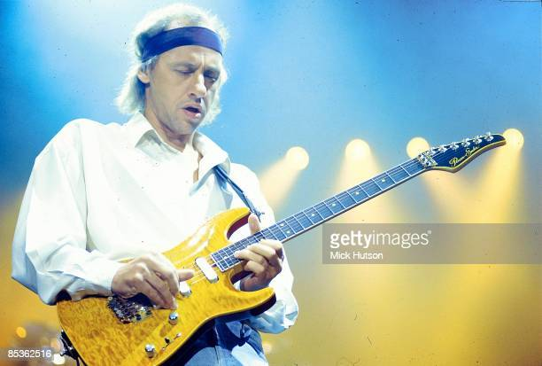 ARENA Photo of DIRE STRAITS and Mark KNOPFLER Mark Knopfler performing live onstage playing Pensa guitar wearing headband