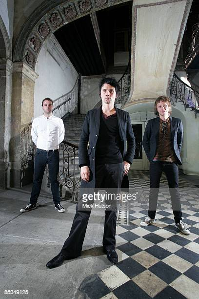Photo of Dominic HOWARD and Matt BELLAMY and Chris WOLSTENHOLME and MUSE; L-R: Chris Wolstenholme, Matt Bellamy, Dominic Howard - posed, group shot