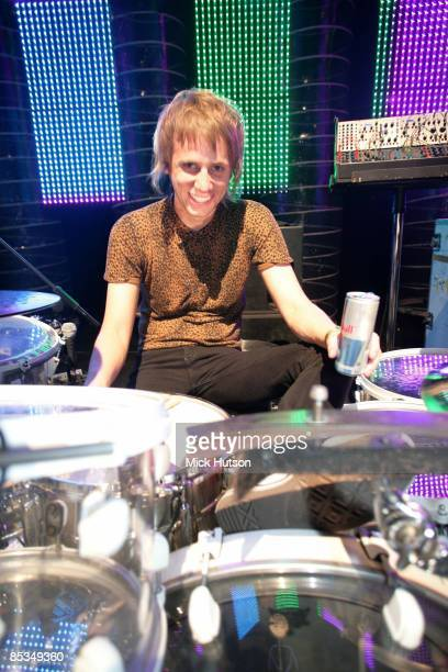Photo of Dominic HOWARD and MUSE Dominic Howard posed in soundcheck at Palacio de los Deportes drinking can of Red Bull