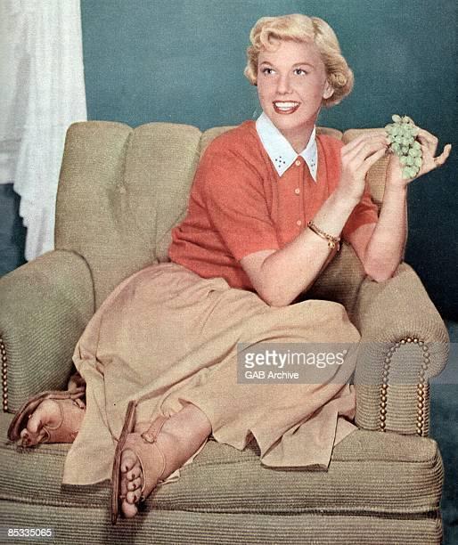 Photo of Doris DAY; Portrait of Doris Day,sitting on chair, grapes