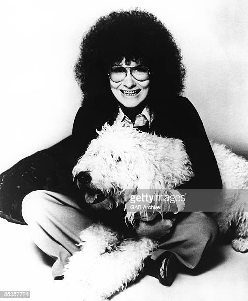 Photo of Dory PREVIN Posed portrait of Dory Previn with pet dog