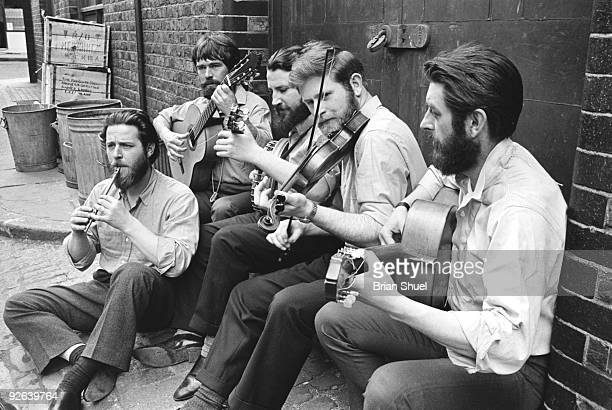 Photo of DUBLINERS Group portrait at the back of Transatlantic Records in Marylebone LR Ciaran Bourke Bob Lynch Barney McKenna John Sheehan and...