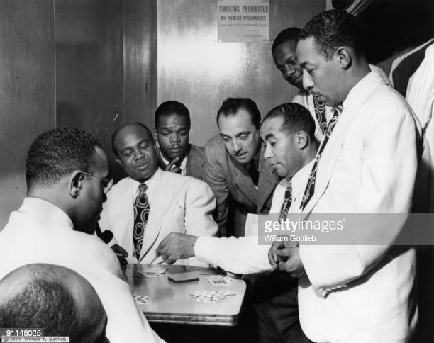 Photo of Duke ELLINGTON The Duke Ellington Group with Django Reinhardt L to R Al Sears Shelton Hemphill Junior Raglin Django Reinhardt Lawrence Brown...