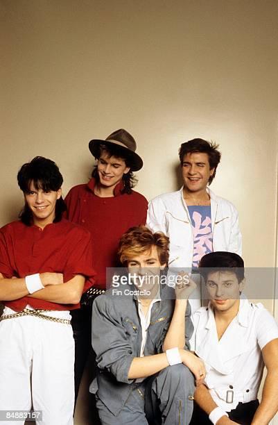 Photo of DURAN DURAN; Back L-R: Andy Taylor, John Taylor, Simon Le Bon. Front L-R: Nick Rhodes, Roger Taylor - posed, studio, group shot