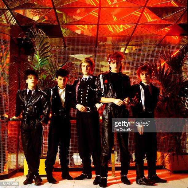 Photo of DURAN DURAN LR Andy Taylor Roger Taylor Simon Le Bon John Taylor Nick Rhodes posed studio group shot