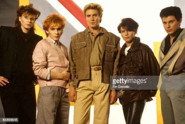 Photo of DURAN DURAN LR John Taylor Nick Rhodes Simon Le Bon Andy Taylor Roger Taylor posed studio group shot
