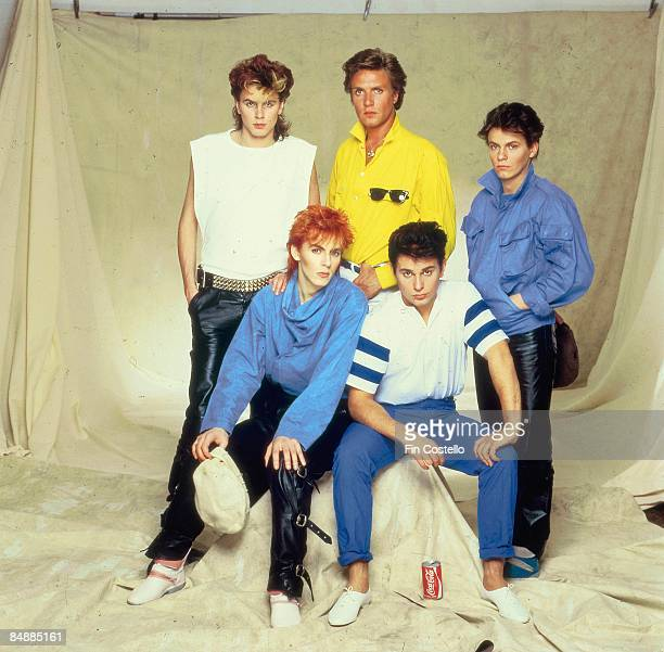 Photo of DURAN DURAN LR John Taylor Simon Le Bon Andy Taylor Nick Rhodes Roger Taylor posed studio group shot