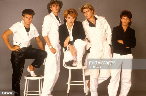 Photo of DURAN DURAN LR Roger Taylor John Taylor Nick Rhodes Simon Le Bon Andy Taylor posed studio group shot 1984/1985 IMAGE REVERSED
