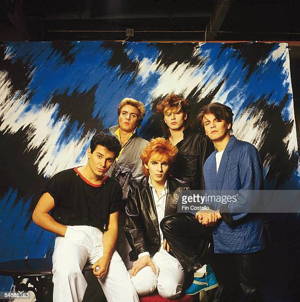 Photo of DURAN DURAN LR Roger Taylor Simon Le Bon Nick Rhodes John Taylor Andy Taylor posed studio group shot
