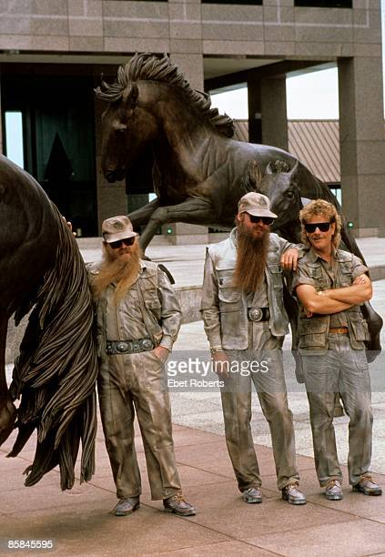 Photo of Dusty HILL and ZZ TOP and Frank BEARD and Billy GIBBONS LR Dusty Hill Billy Gibbons Frank Beard posed group shot