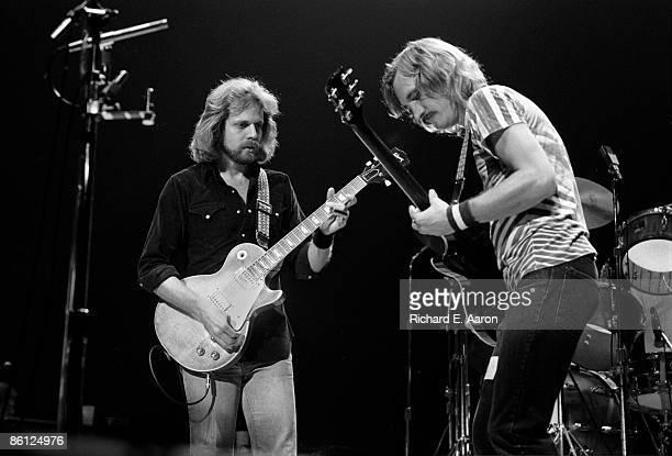 Photo of EAGLES and Don FELDER and Joe WALSH LR Don Felder and Joe Walsh performing on stage