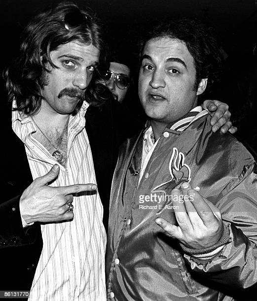 Photo of EAGLES and Glenn FREY and John BELUSHI Glenn Frey with John Belushi at a party