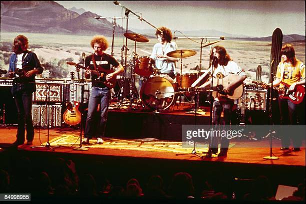 Photo of EAGLES; !IMAGE REVERSED! - L-R: Don Felder, Bernie Leadon, Don Henley, Glenn Frey, Randy Meisner - performing live onstage c.1974/1975