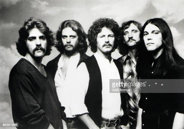 Photo of EAGLES LR Glenn Frey Don Felder Don Henley Joe Walsh and Timothy BSchmitt posed studio group shot