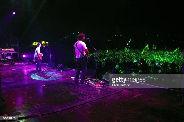 FESTIVAL Photo of Ed O'BRIEN and RADIOHEAD and Thom YORKE Thom Yorke and Ed O'Brien performing live onstage view from stage looking out over audience