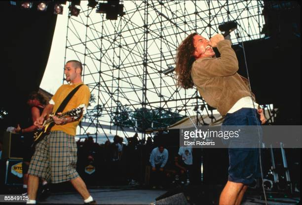 UNITED STATES AUGUST 01 LOLAPOLOOZA Photo of Eddie VEDDER and PEARL JAM and Stone GOSSARD LR Stone Gossard and Eddie Vedder performing live onstage