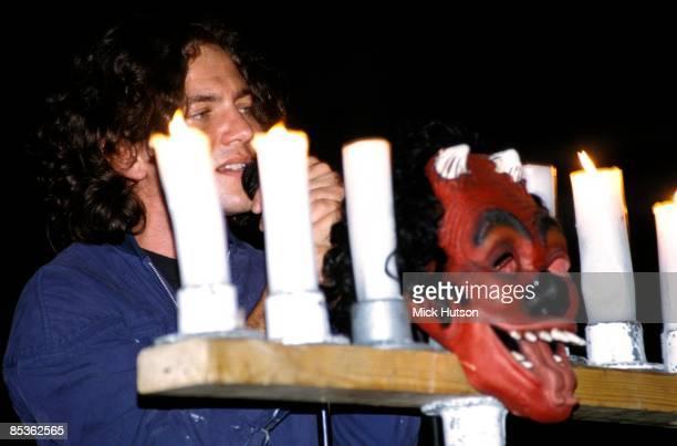 Photo of Eddie VEDDER and PEARL JAM Eddie Vedder performing live onstage behind candles