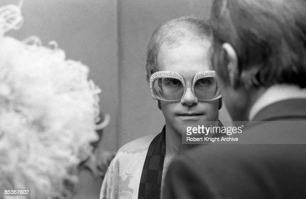 Photo of Elton JOHN and Jack LORD Elton John backstage with Hawaii FiveO actor Jack Lord