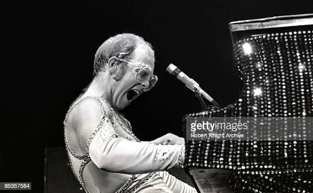 Photo of Elton JOHN Elton John performing on stage piano profile