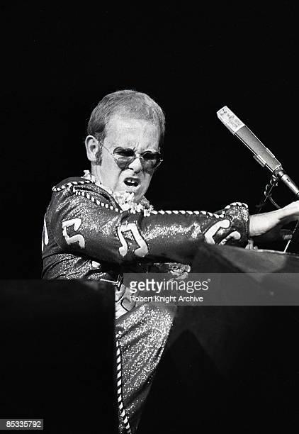 Photo of Elton JOHN Elton John performing on stage sunglasses