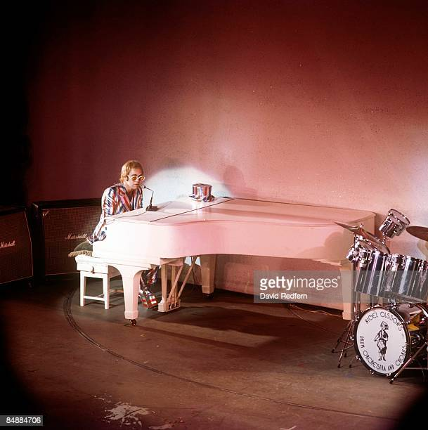 PALLADIUM Photo of Elton JOHN playing white grand piano performing live onstage