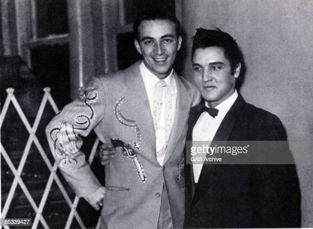 Photo of Elvis PRESLEY and Faron YOUNG with Faron Young posed