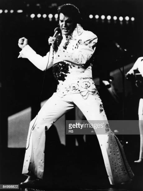 HONOLULU Photo of Elvis PRESLEY Elvis Presley performing live onstage at 'Aloha From Hawaii' concert full length wearing white jumpsuit