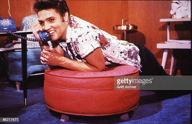 Photo of Elvis PRESLEY; posed, on phone