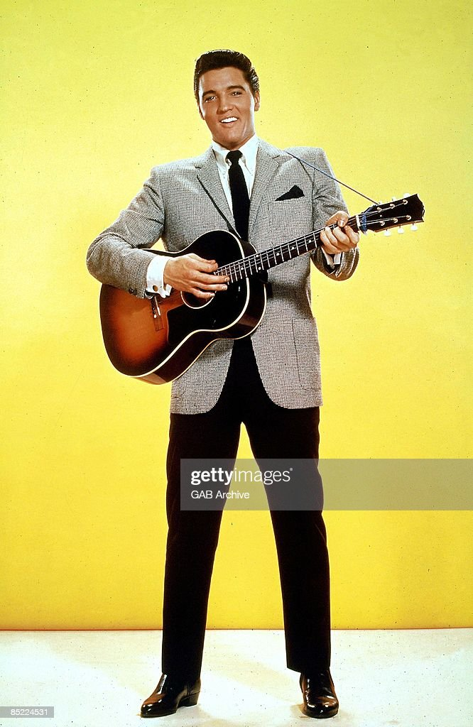 USA Photo of Elvis PRESLEY, posed, studio, with acoustic guitar