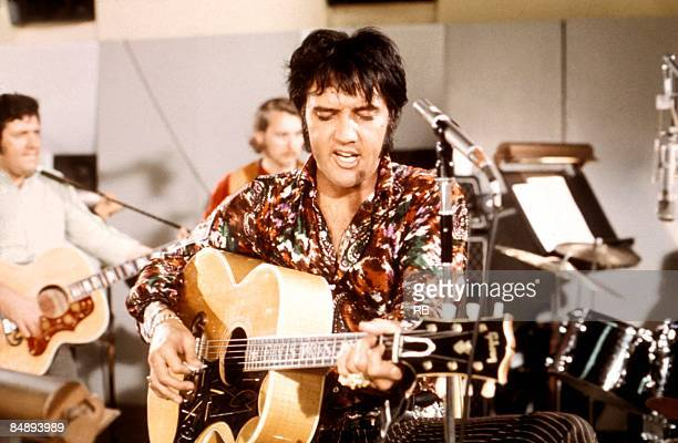 Photo of Elvis PRESLEY still from the film 'That's The Way It Is' playing Gibson J200 acoustic guitar rehearsing songs at MGM studios