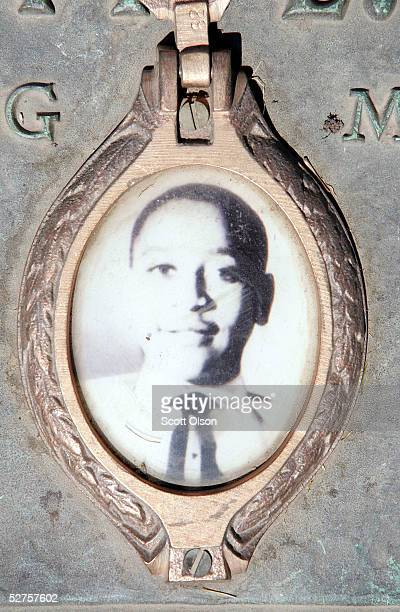A photo of Emmett Till is included on the plaque that marks his gravesite at Burr Oak Cemetery May 4 2005 in Aslip Illinois The FBI is considering...