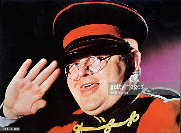 Photo of English comedian Benny Hill dressed as his character Fred Scuttle posed circa 1975