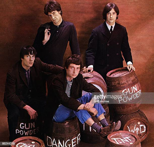 Photo of KINKS LR Mick Avory Ray Davies Pete Quaife Dave Davies posed studio group shot sitting on barrels of gun powder