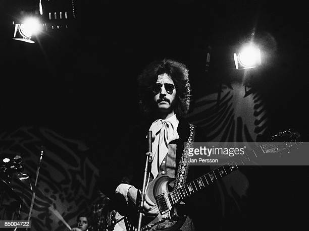 Photo of Eric CLAPTON and CREAM Eric Clapton filming a TV show playing Gibson SG Guitar wearing sunglasses and moustache