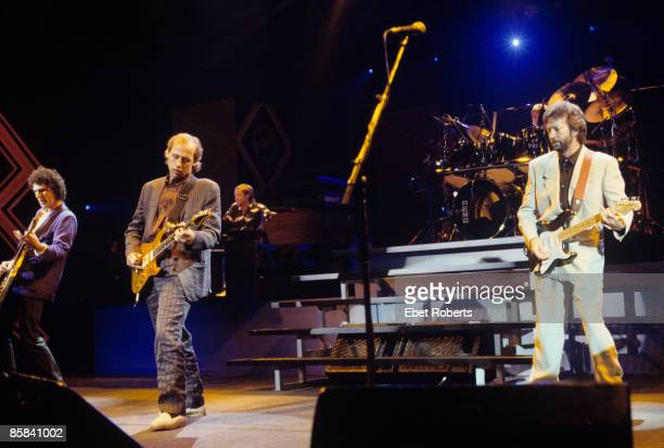 UNITED STATES JANUARY 01 Photo of Eric CLAPTON and DIRE STRAITS and John ILLSLEY and Alan CLARK and Mark KNOPFLER LR John Illsley Mark Knopfler Alan...