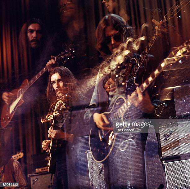 Photo of Eric CLAPTON and George HARRISON with Eric Clapton performing live onstage with Delaney Bonnie