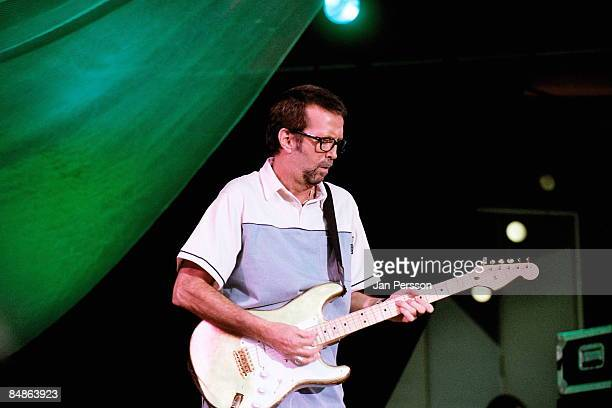 Photo of Eric CLAPTON performing live onstage at Legends concert playing Fender Stratocaster guitar