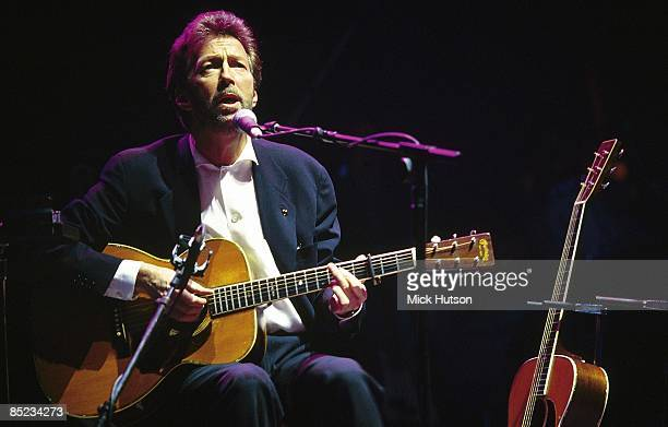 Photo of Eric CLAPTON, performing live onstage, playing Martin acoustic guitar