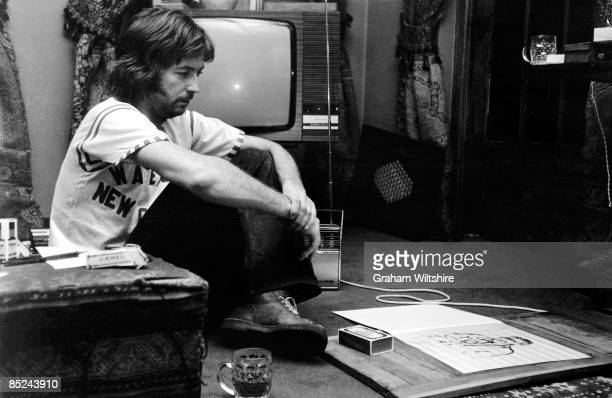 Photo of Eric CLAPTON posed with drawings at home in Ewhurst Surrey