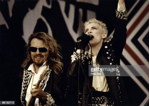 Photo of EURYTHMICS and Dave STEWART and Annie LENNOX, Dave Sterwart and Annie Lennox performing on stage at the Nelson Mandela 70th Birthday Tribute...