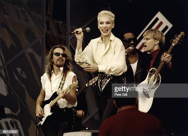 Photo of EURYTHMICS and Dave STEWART and Annie LENNOX, Dave Stewart and Annie Lennox performing on stage at the Nelson Mandela 70th Birthday Tribute...