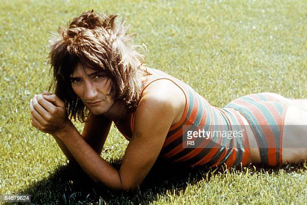 Photo of FACES and Rod STEWART posed portrait of Rod Stewart lying on grass wearing striped bathing costume Faces era