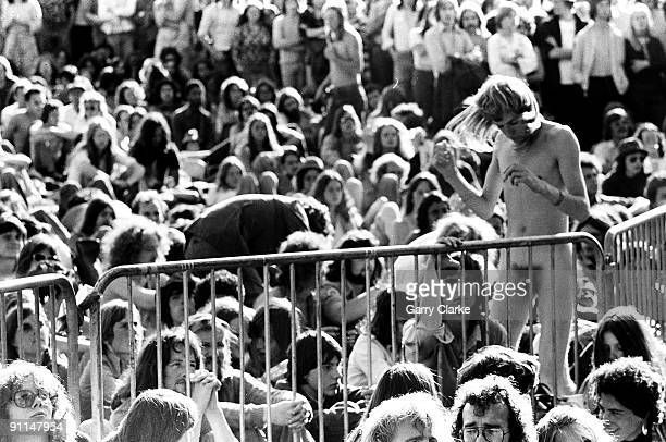 KNEBWORTH Photo of FANS and AUDIENCE and 70's STYLE and HIPPIES and CROWDS Naked fans dancing in audience at outdoor concert festival amongst crowds...