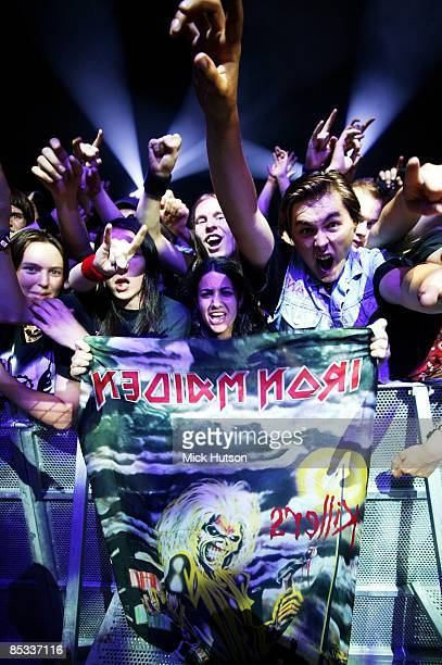 AREENA Photo of FANS and IRON MAIDEN Iron Maiden fans in front row of sueicne at concert / gig holding up poster cheering shouting
