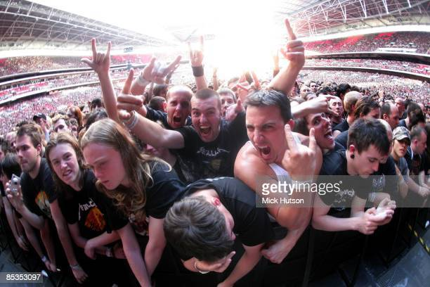STADIUM Photo of FANS Fans cheering in the audience at Metallica gig devil horns