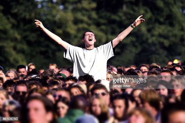 Photo of FANS, Male fan with arms out at Knebworth House concert