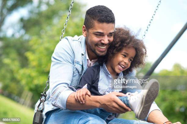 Photo of father and daughter having fun at the park