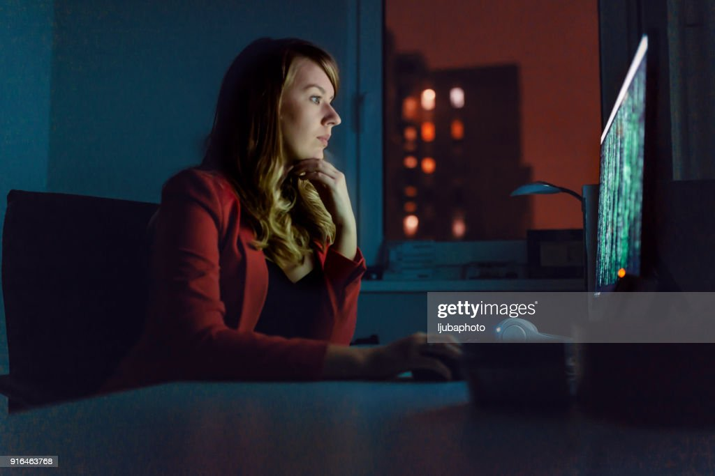 Photo of Female Hacker Working on a PC : Stock Photo