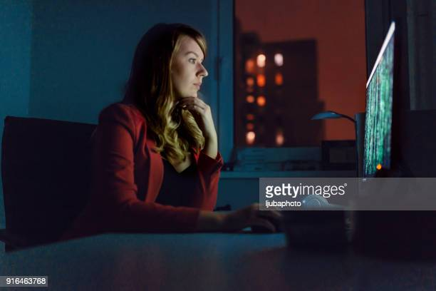 Photo of Female Hacker Working on a PC